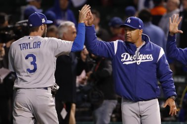 Dodgers manager Roberts high fives Taylor in the NLCS