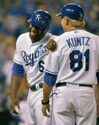 Royals Cain smiles after infield single