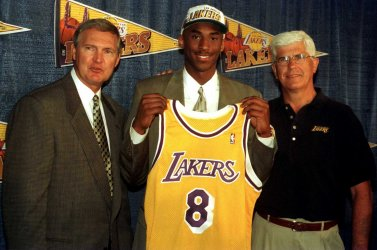 First-round draft pick Kobe Bryant poses with new LA Lakers jersey after making deal
