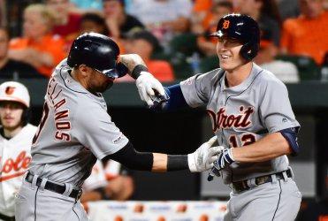 Tigers' Brandon Dixon celebrates 9th inning two-run homer with Nicholas Castellanos