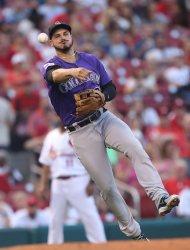Colorado Rockies third baseman Noland Arenado makes throw