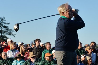 Honorary starter Jack Nicklaus hits a tee shot at the Masters