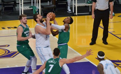 Lakers Defeat Mavericks for First Win of the Season