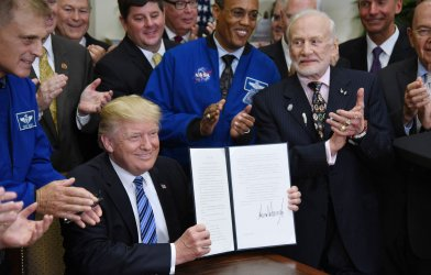 U.S President Donald Trump signs an Executive Order on space exploration