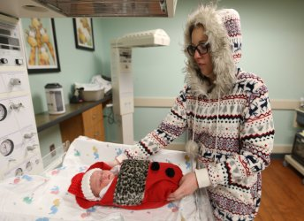 New born babies are placed in Christmas stockings