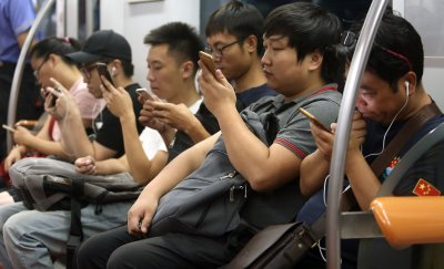 Chinese students use their smartphones in Beijing, China