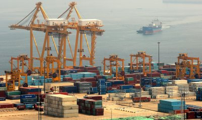 A commercial container is loaded at Dalian's port, China