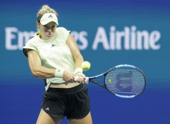 Catherine McNally hits a backhand at the US Open