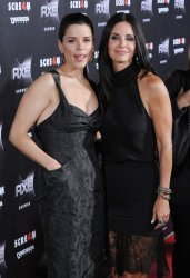 """Neve Campbell and Courteney Cox arrive at the """"Scream 4"""" premiere in Los Angeles"""