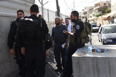 Israeli Police Check Palestinians At Checkpoint