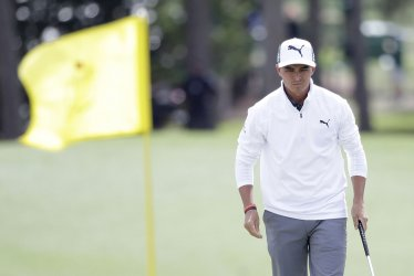 Rickie Fowler reacts after missing a putt at the Masters