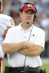 Redskins coach Jay Gruden paces the sideline during a timeout against the Chargers in Carson, California