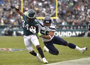 Eagles' Greg Ward is tackled by Seattle Seahawks' Mychal Kendricks