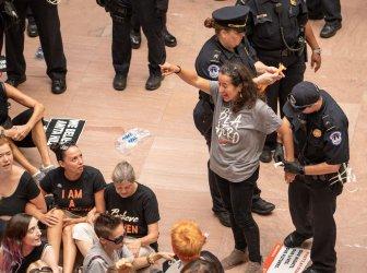 Protestor arrested during demonstration against Judge Brett Kavanaugh in Hart Senate Office Buiilding Atrium
