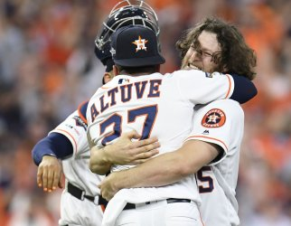 Astros Cole celebrates winning in ALDS game five in Houston