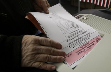Voters cast their ballots in New Hampshire presidential primary in Nashua, New Hampshire.