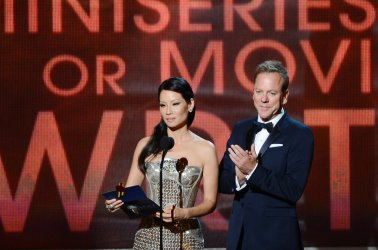 Kiefer Sutherland and Lucy Liu attend the 64th Primetime Emmy Awards in Los Angeles