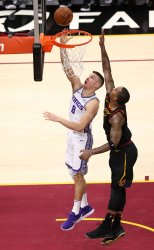 Sacramento Kings' Bogdan Bogdanovic lays the ball in for two while defended by Cleveland Cavaliers J.R. Smith