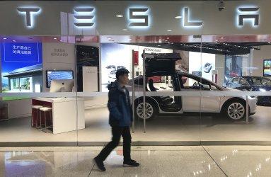 Chinese visit Tesla's new showroom in Beijing, China