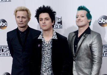 Mike Dirnt, Billie Joe Armstrong and Tre Cool attend the 2016 American Music Awards in Los Angeles