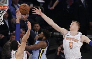 New York Knicks Kristaps Porzingis plays defense
