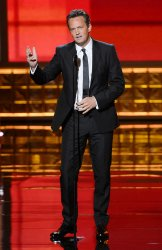 Actor Matthew Perry attend the 64th Primetime Emmy Awards in Los Angeles