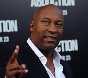 "John Singleton attends the ""Abduction"" premiere in Los Angeles"
