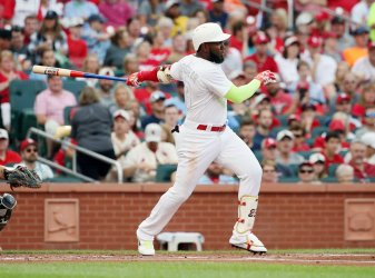 St. Louis Cardinals Marcell Ozuna hits two RBI single