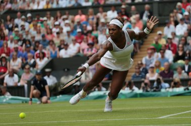 Serena Williams dives for a ball.