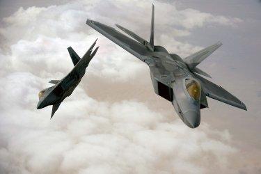 F-22 Raptors fly in formation