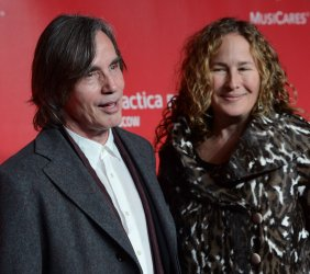 Jackson Brown and Dianna Cohen arrive at 2013 MusiCares Person of the Year gala in Los Angeles