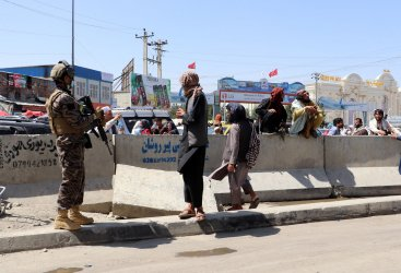 Taliban Fighters Stand Guard Outside International Airport