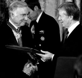 WALTER CRONKITE ACCEPTING MEDAL OF FREEDOM FROM JIMMY CARTER
