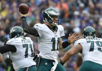 Eagles QB Carson Wentz throws against Ravens