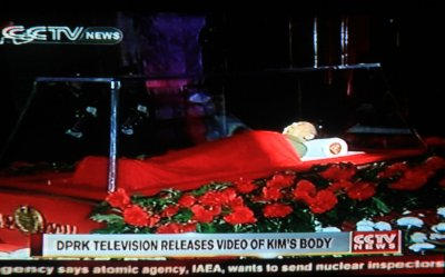 Television footage of KIm Jong-Il's body is shown in Beijing