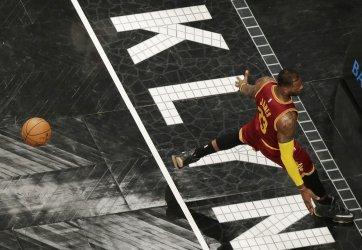 Cavaliers LeBron James dunks the basketball