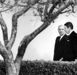 PRESIDENT REAGAN AND MIKHAIL GORBACHEV CHAT AS THEY WALK