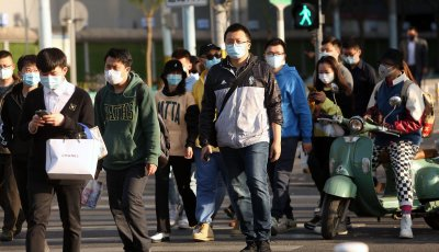 Chinese continue to wear protective face masks in Beijing, China