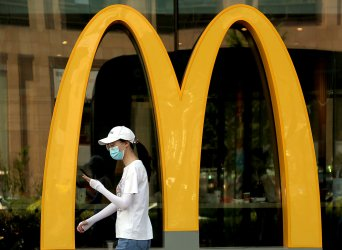 Chinese Walk Past a McDonald's in Beijing, China