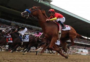 Justify wins the Triple Crown at 150th Belmont Stakes