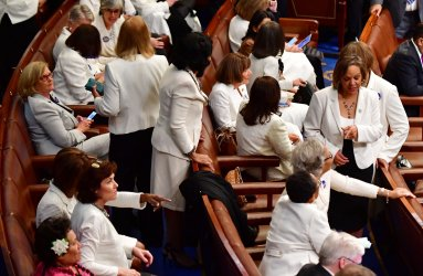 Female Democratic legislators wear all white as a symbol of unity at Joint Session of Congress