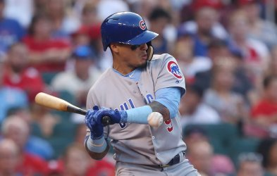 Chicago Cubs Javier Baez is hit by pitch