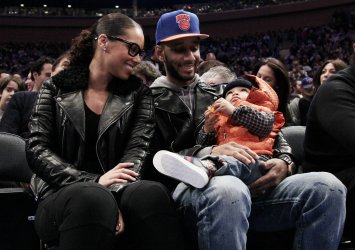 Alicia Keys, Swizz Beatz and their son Egypt at Madison Square Garden in New York