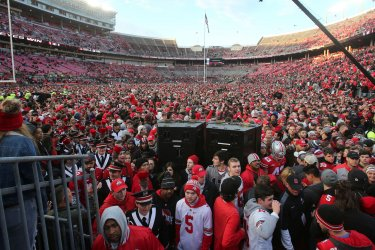 Ohio State fans cover the field after crushing Michigan 62-39