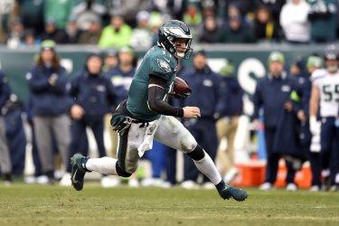 Eagles quarterback Carson Wentz (11) runs the ball
