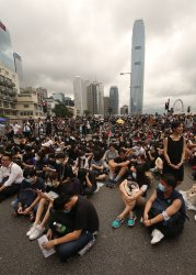 Protesters block a road to the government's offices in Hong Kong