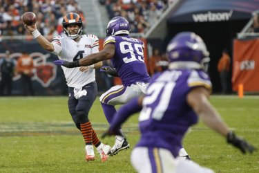 Bears Chase Daniel looks to pass the ball against Vikings in Chicago