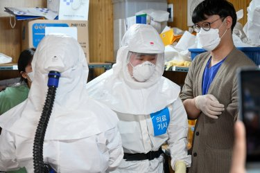 Healthcare Workers Wear Protective Gear