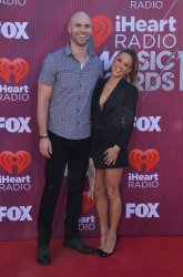 Michael Caussin and Jana Kramer attend the iHeartRadio Music Awards in Los Angeles