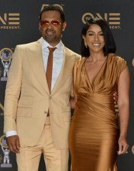 Mike Epps and Kyra Robinson backstage at the 50th NAACP Image Awards in Los Angeles